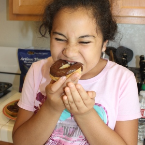 Oops... the chocolate may have still been a little hot.  But she still gave the doughnut a thumbs up!